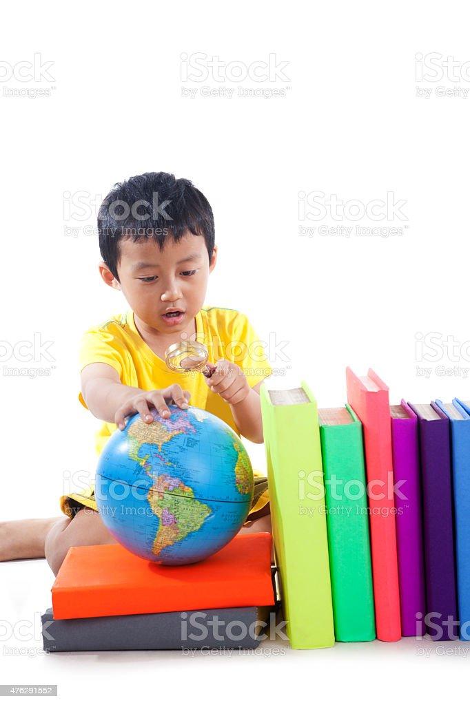 Elementary school student with globe stock photo