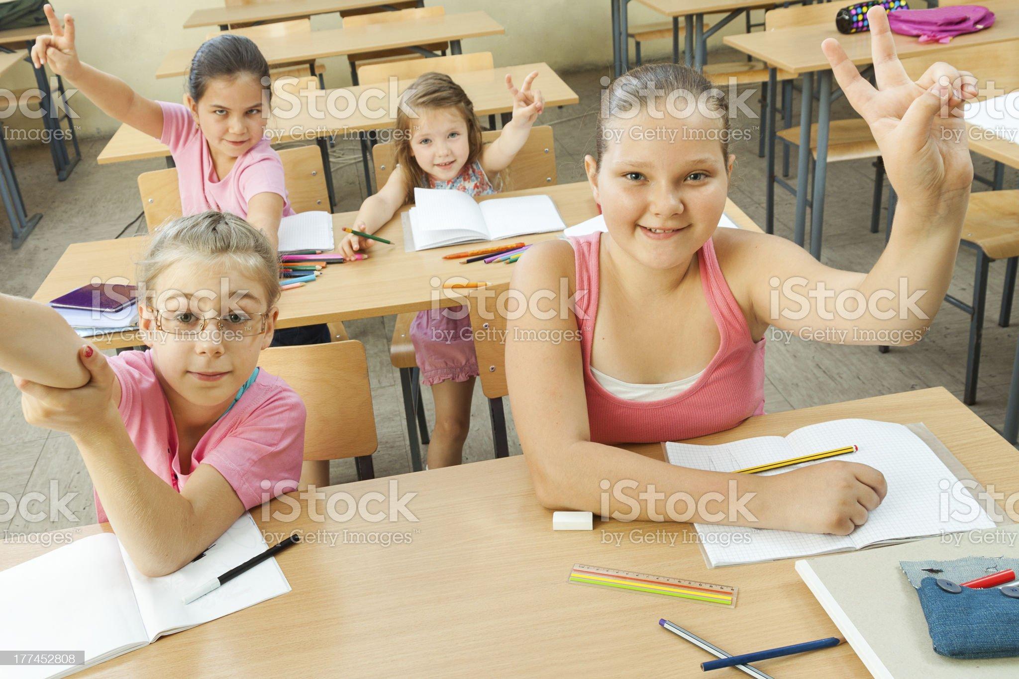 Elementary School Students at Classroom Desks royalty-free stock photo