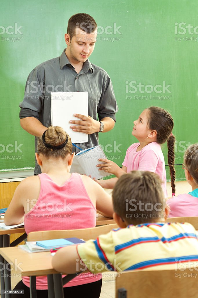 Elementary School Students at Classroom Desks royalty-free stock photo
