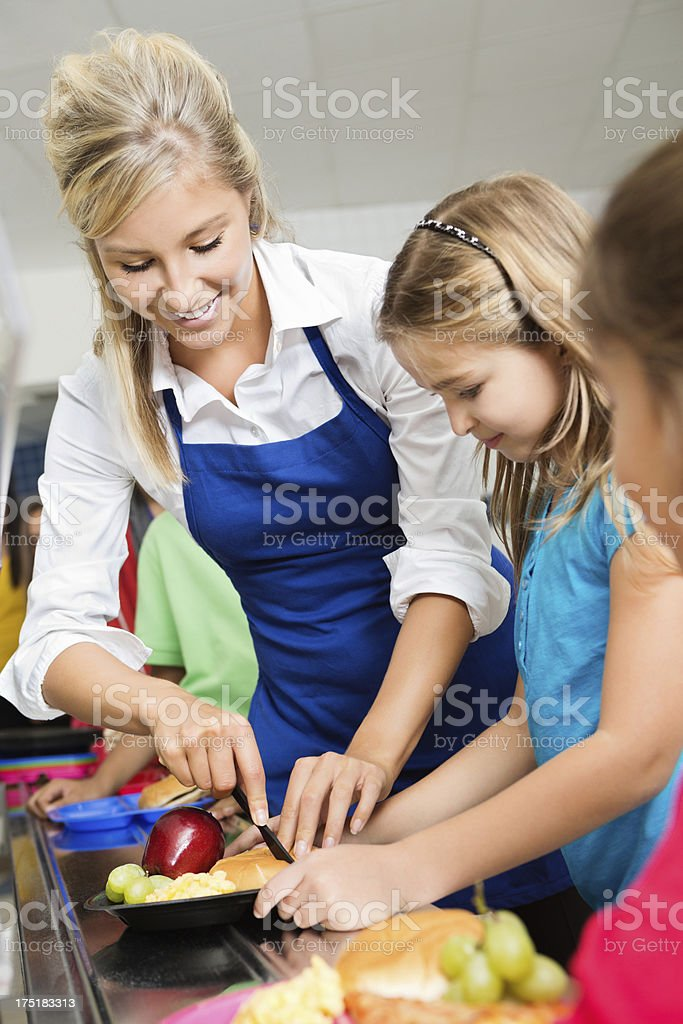 Elementary school students buying lunch in cafeteria line royalty-free stock photo