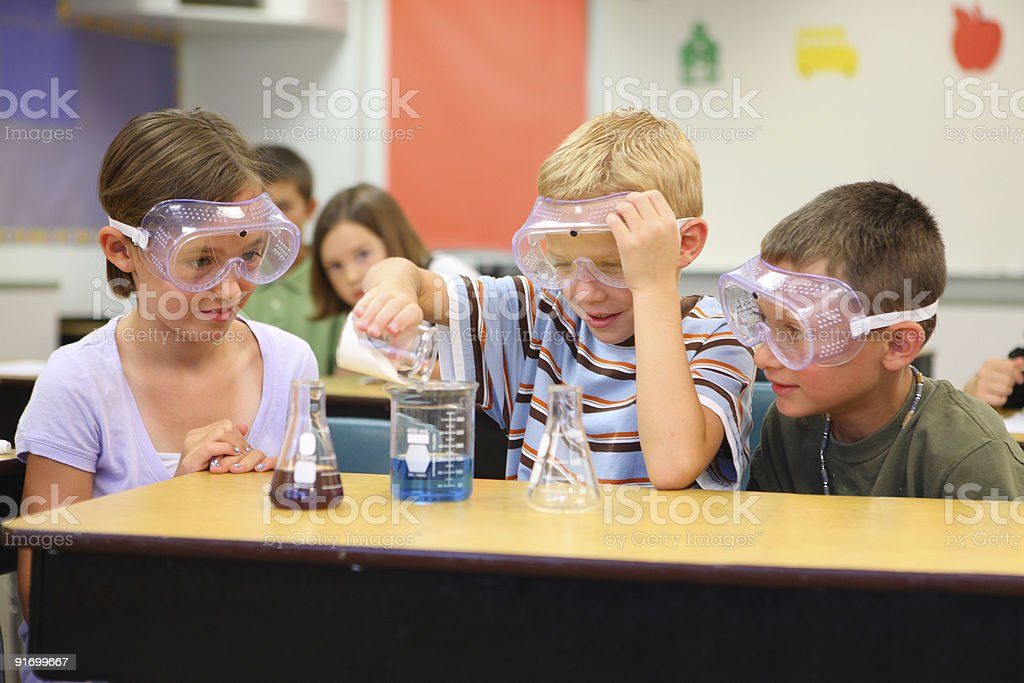 Elementary school students doing a science experiment stock photo