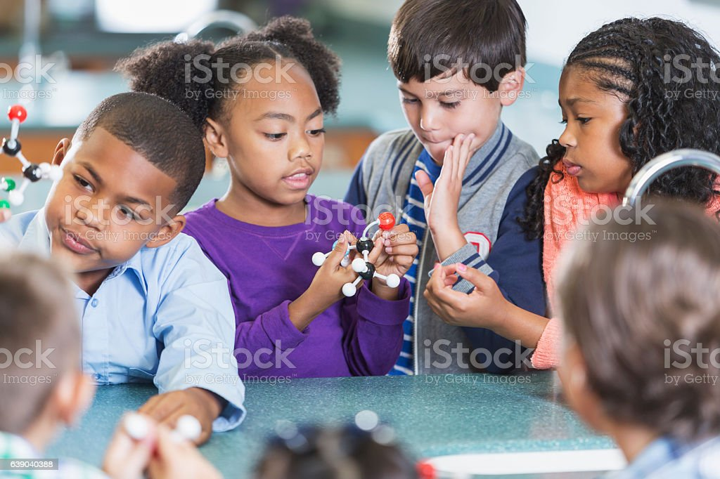 Elementary school students in science class stock photo