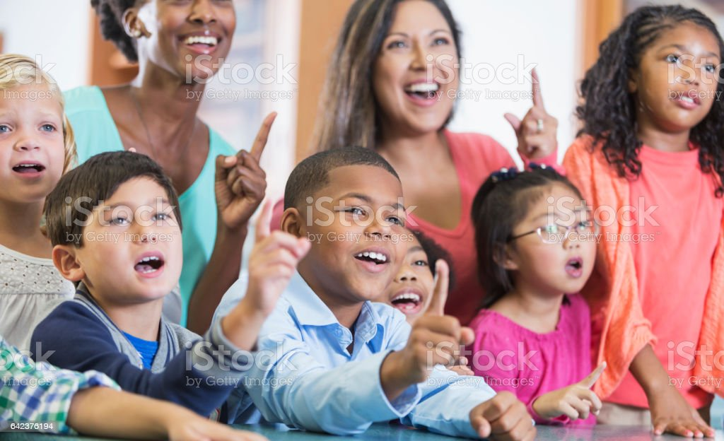 Elementary school students, teachers in classroom stock photo