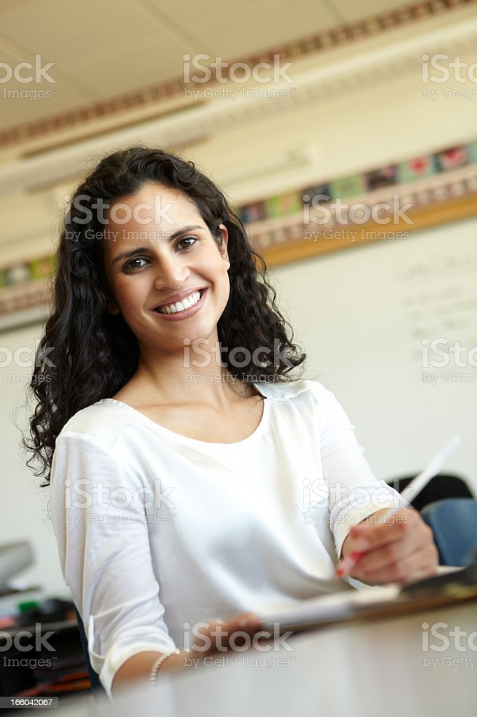 Elementary School Teacher In Classroom royalty-free stock photo