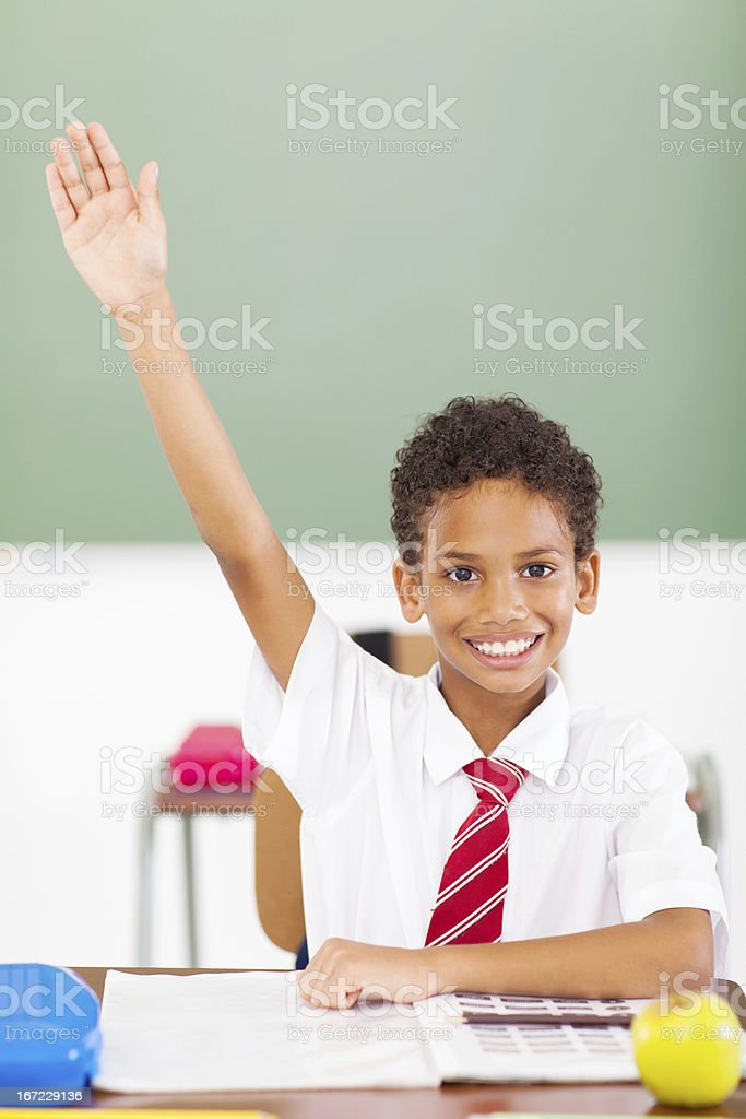 elementary schoolboy arm up in classroom royalty-free stock photo