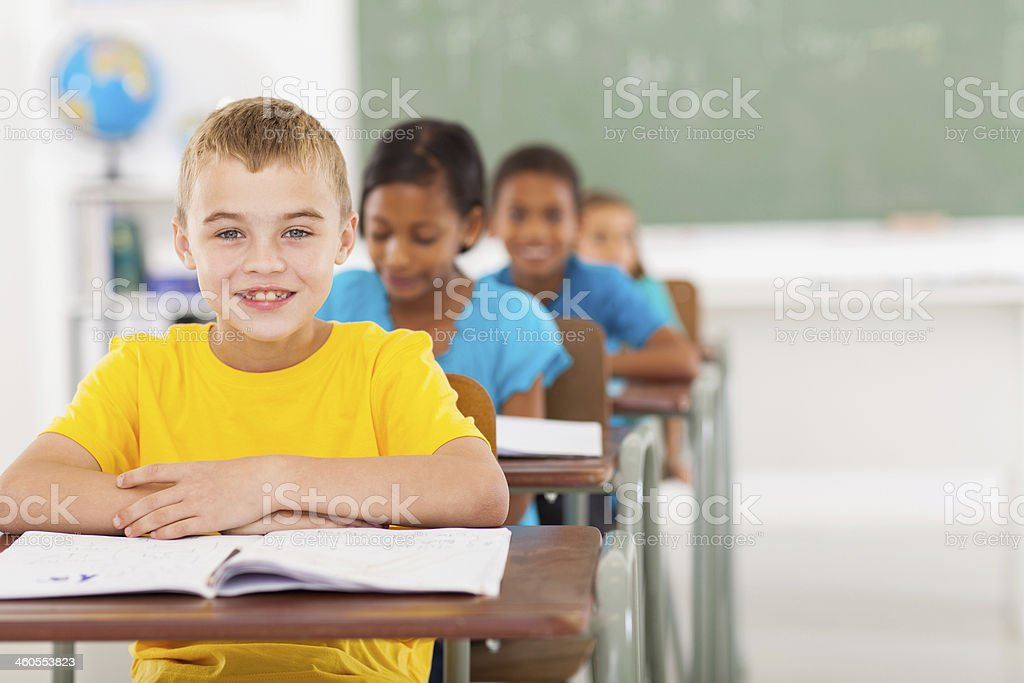 elementary schoolboy with classmates stock photo