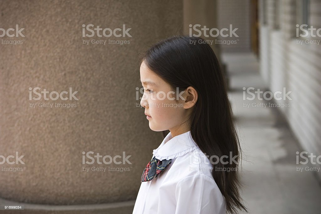 elementary schoolgirl in school uniform royalty-free stock photo
