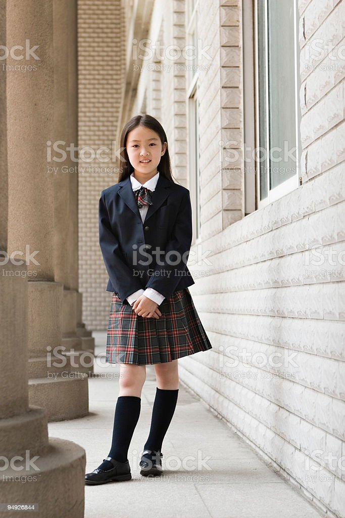 elementary schoolgirl in school uniform royalty-free stock photo