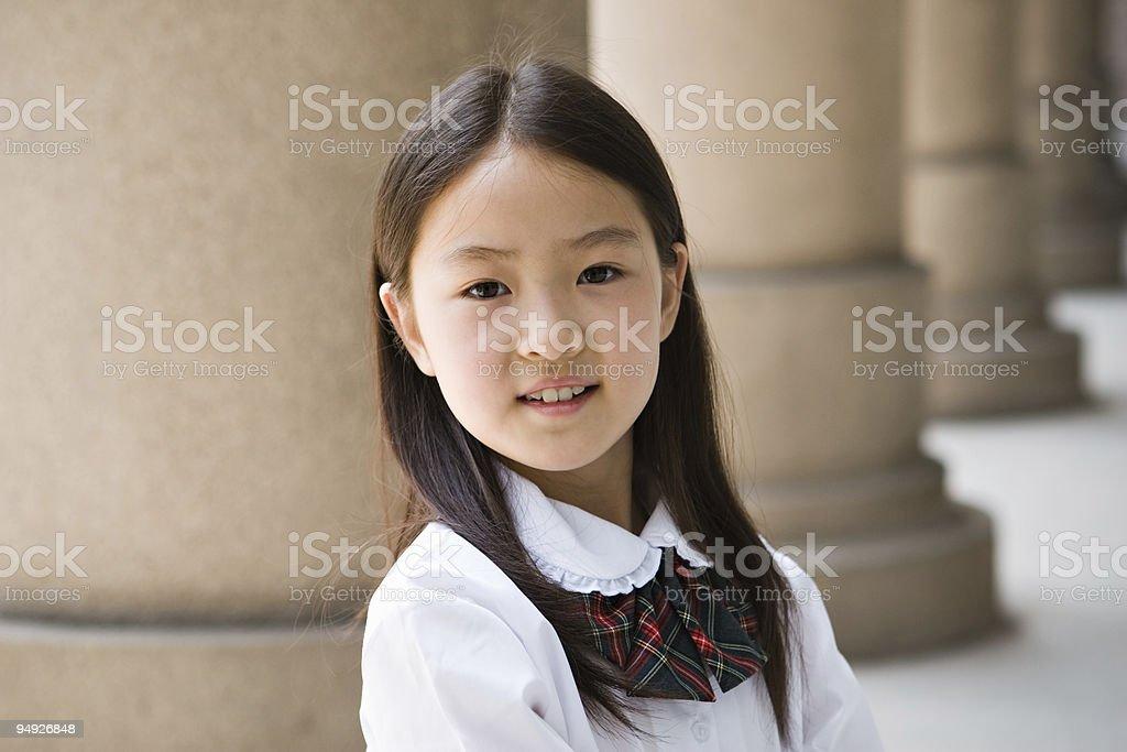 elementary schoolgirl smiling royalty-free stock photo