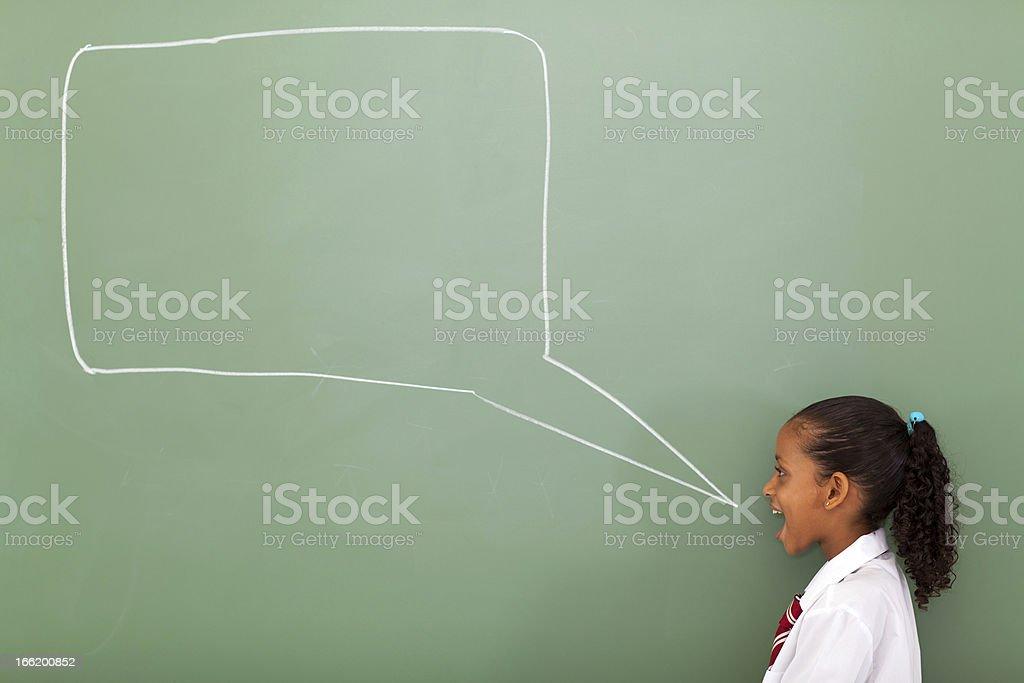 elementary schoolgirl with speech bubble royalty-free stock photo