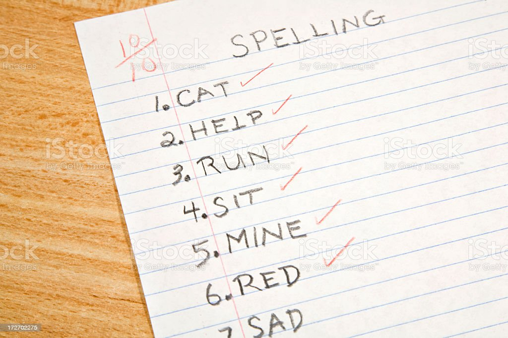 A+ elementary spelling test corrected by teacher stock photo