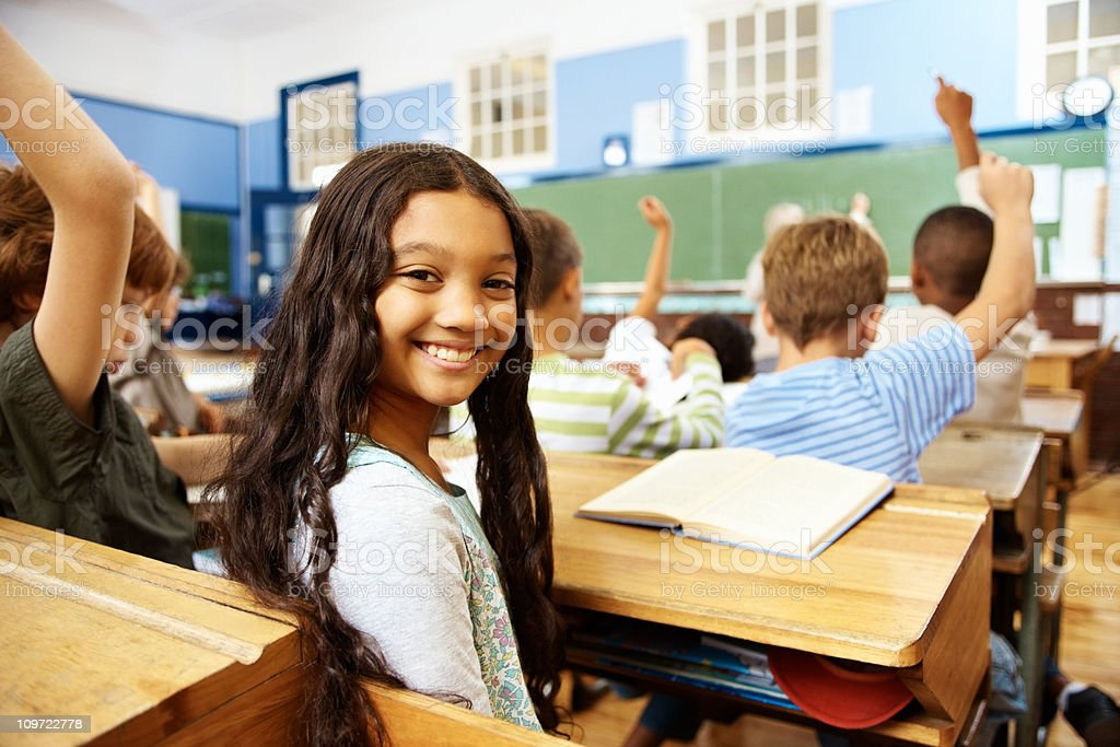 Elementary student smiling in classroom royalty-free stock photo