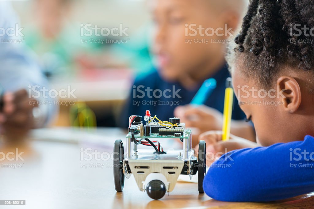 Elementary student using robotics kit in science class stock photo