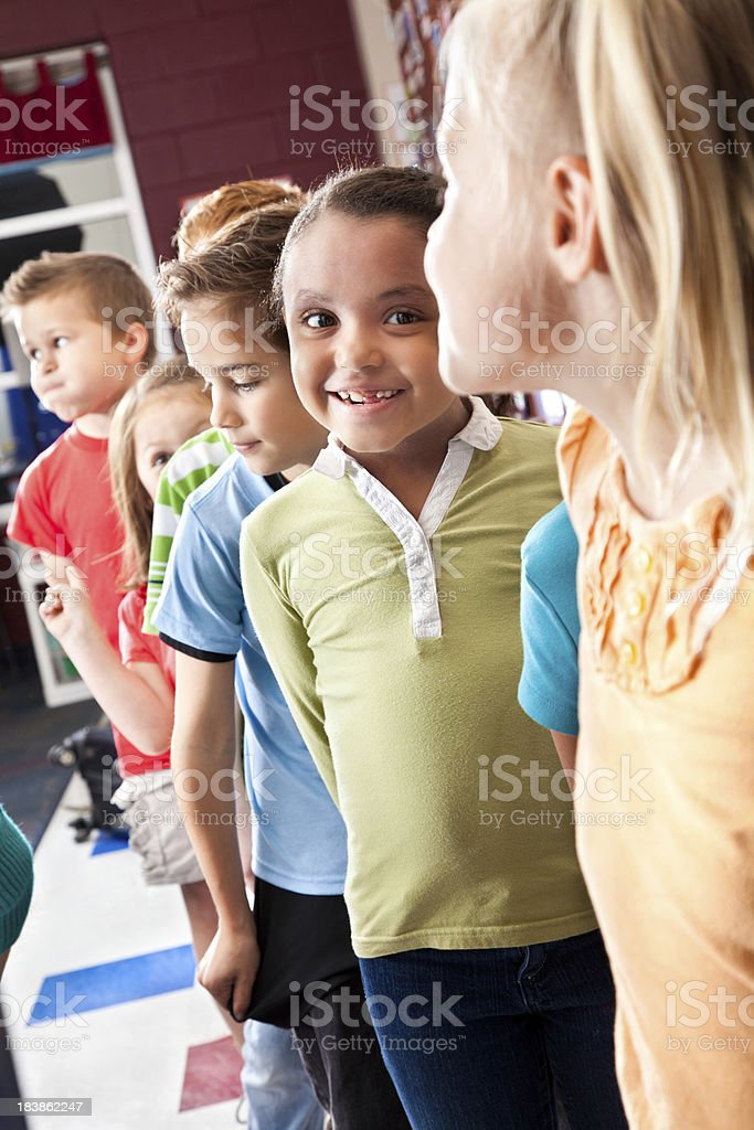 Elementary students at their classroom, waiting in line royalty-free stock photo