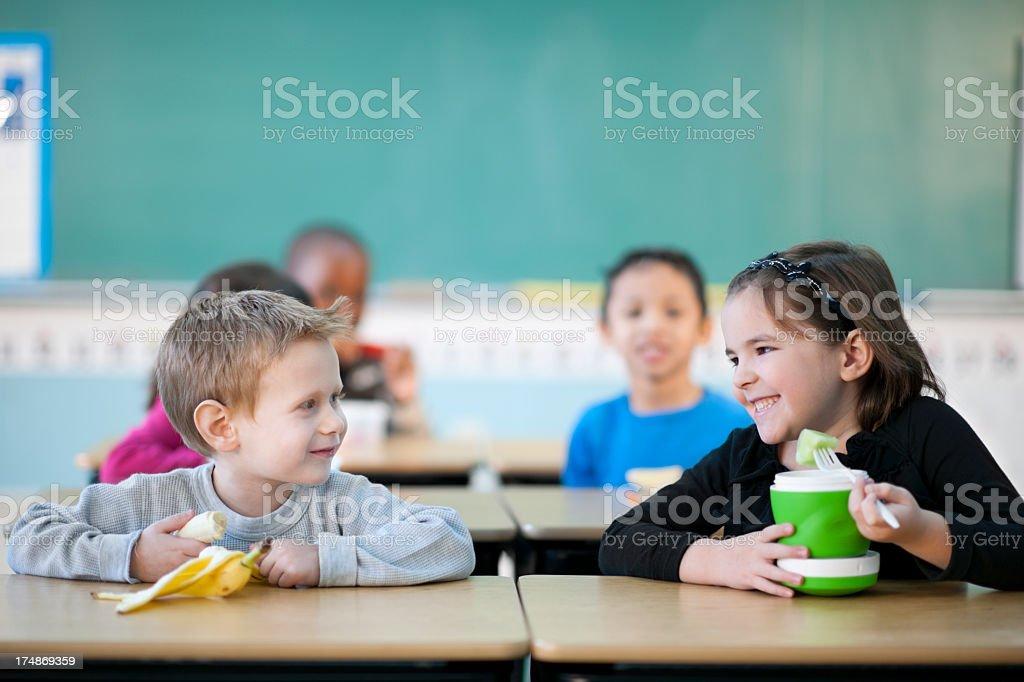elementary students having their snacks stock photo