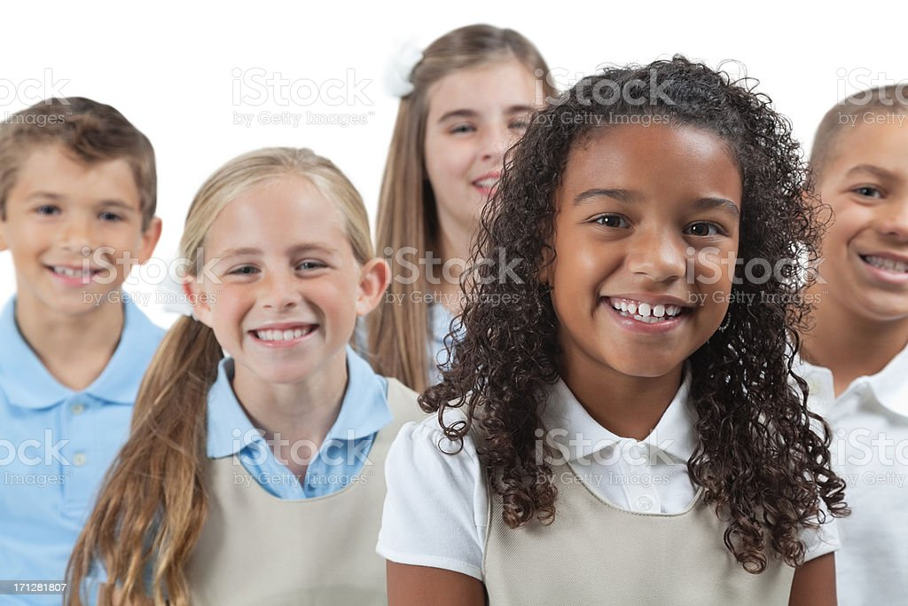 Elementary students in school uniforms, on  white background royalty-free stock photo