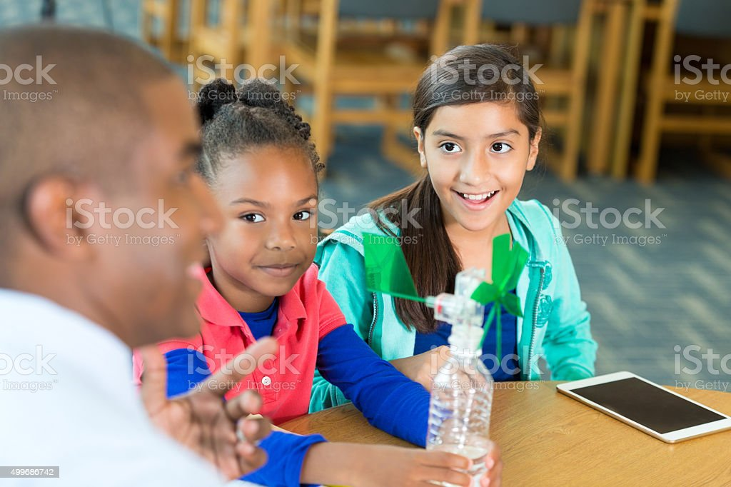 Elementary students learning about wind technology in science class stock photo