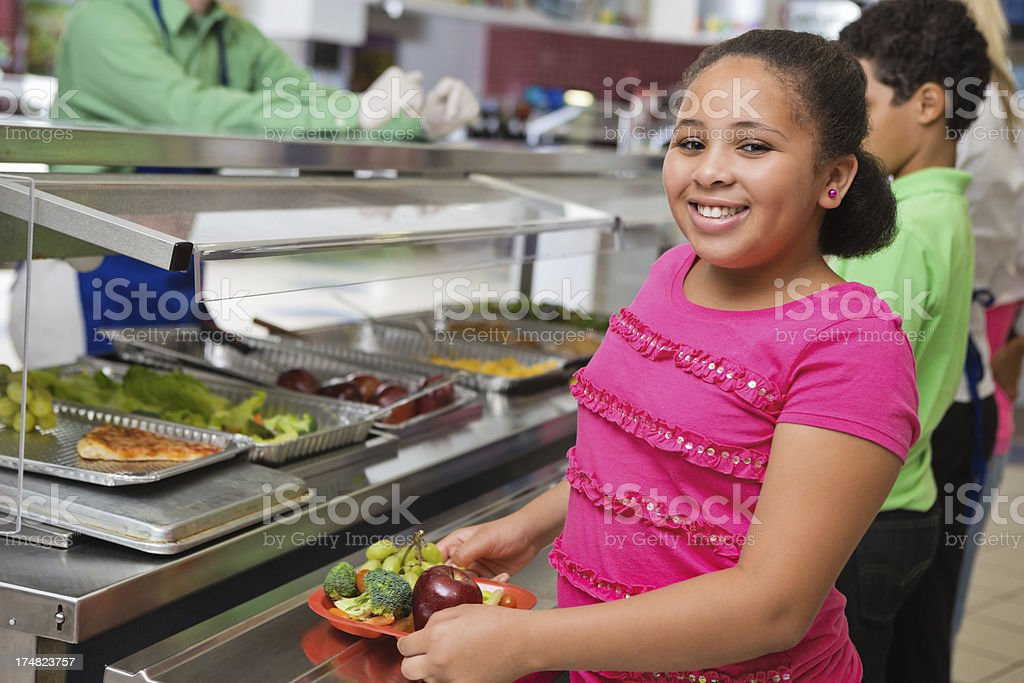 Elementary students making healthy choices in school lunch line stock photo