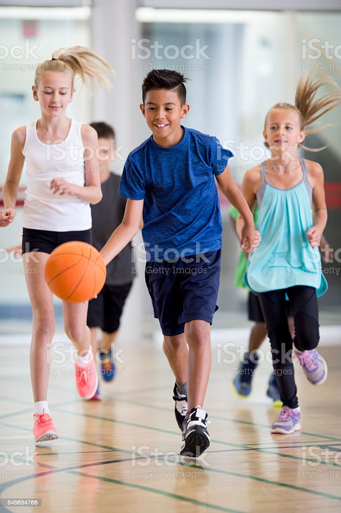 Elementary Students Playing Basketball stock photo