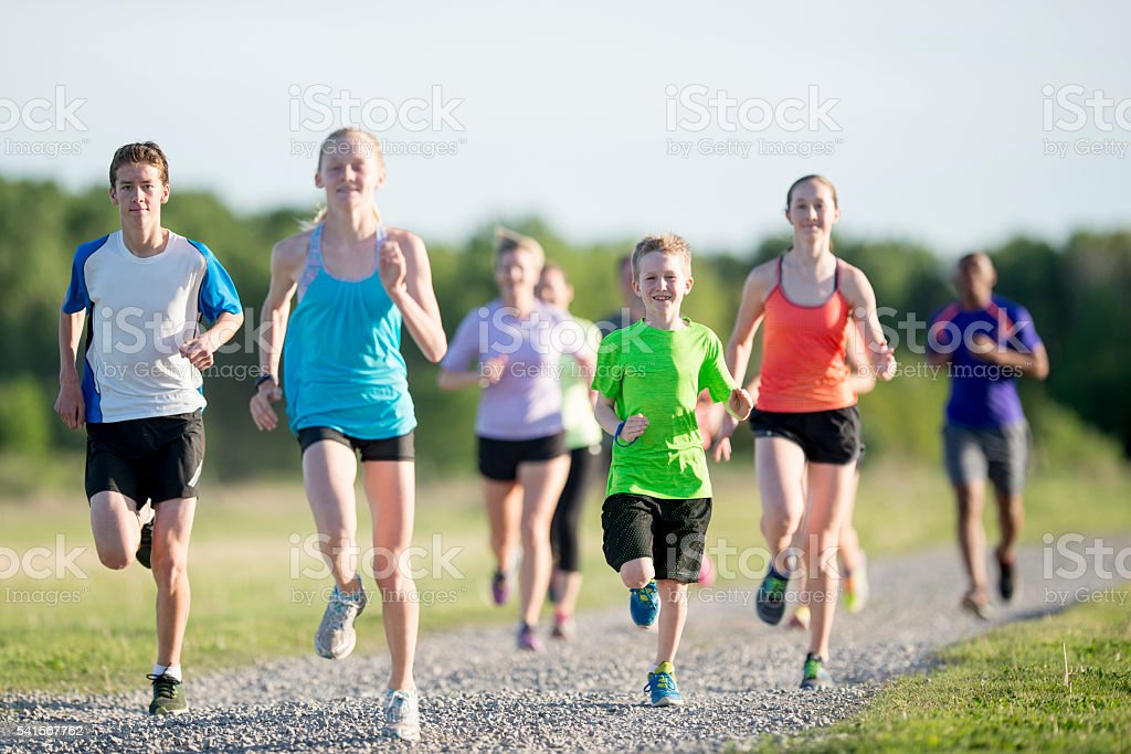 Elementary Students Running Outside stock photo