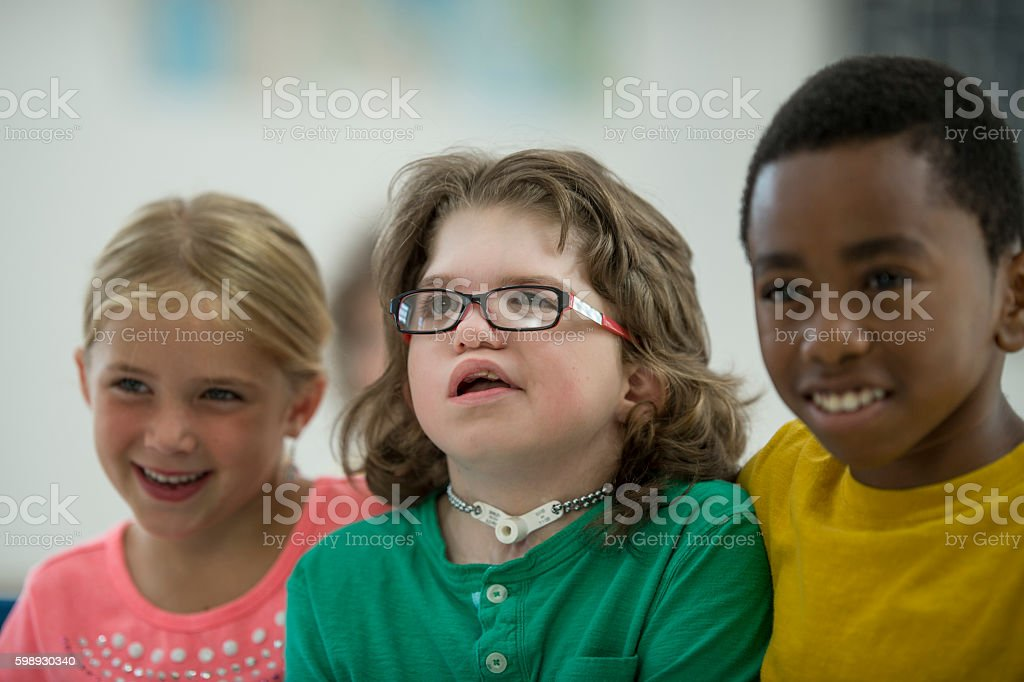 Elementary Students Sitting Together stock photo
