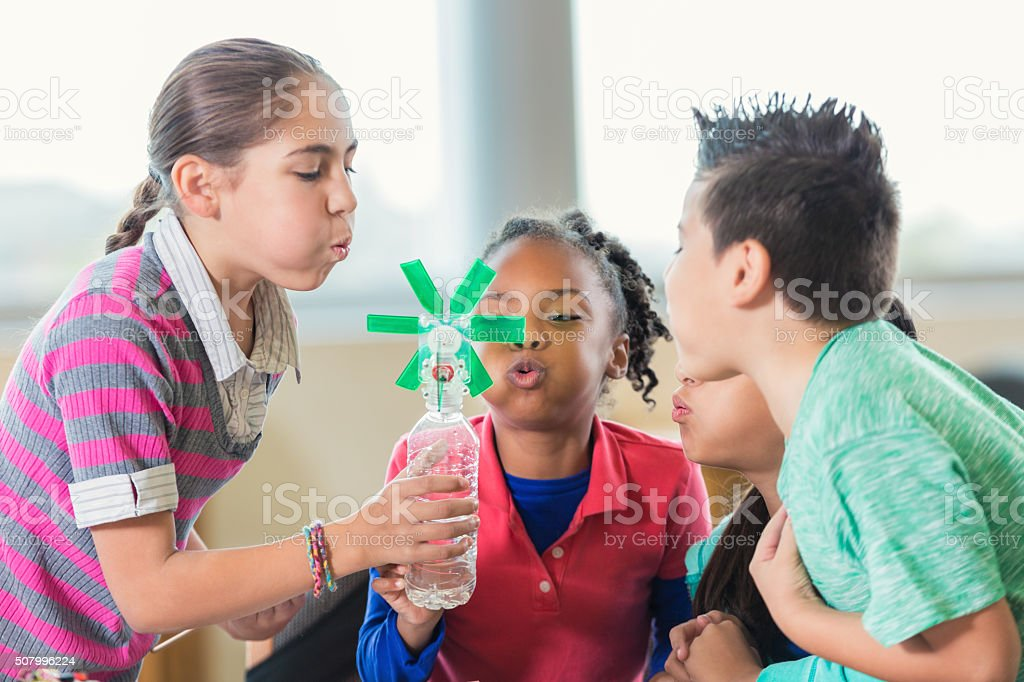 Elementary students studying alternative wind energy in science class stock photo