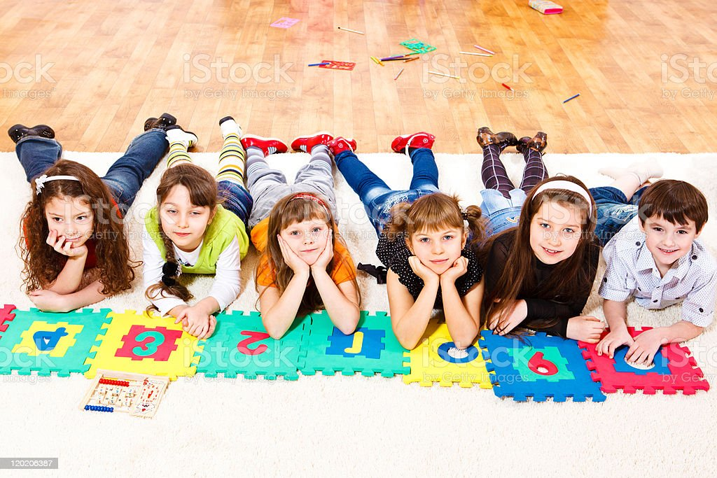 Elementary students with puzzle piece numbers royalty-free stock photo