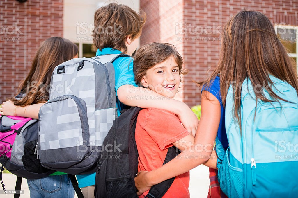 Elementary-age children going back to school. stock photo