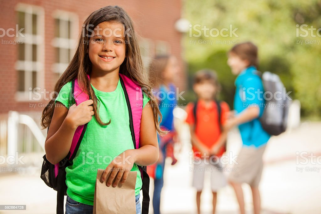 Elementary-age children on school campus. stock photo