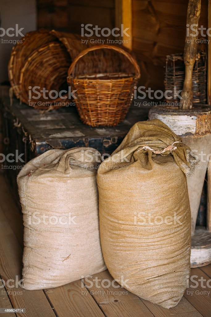 Elements of life of Russian peasants: sacs, wicker baskets stock photo