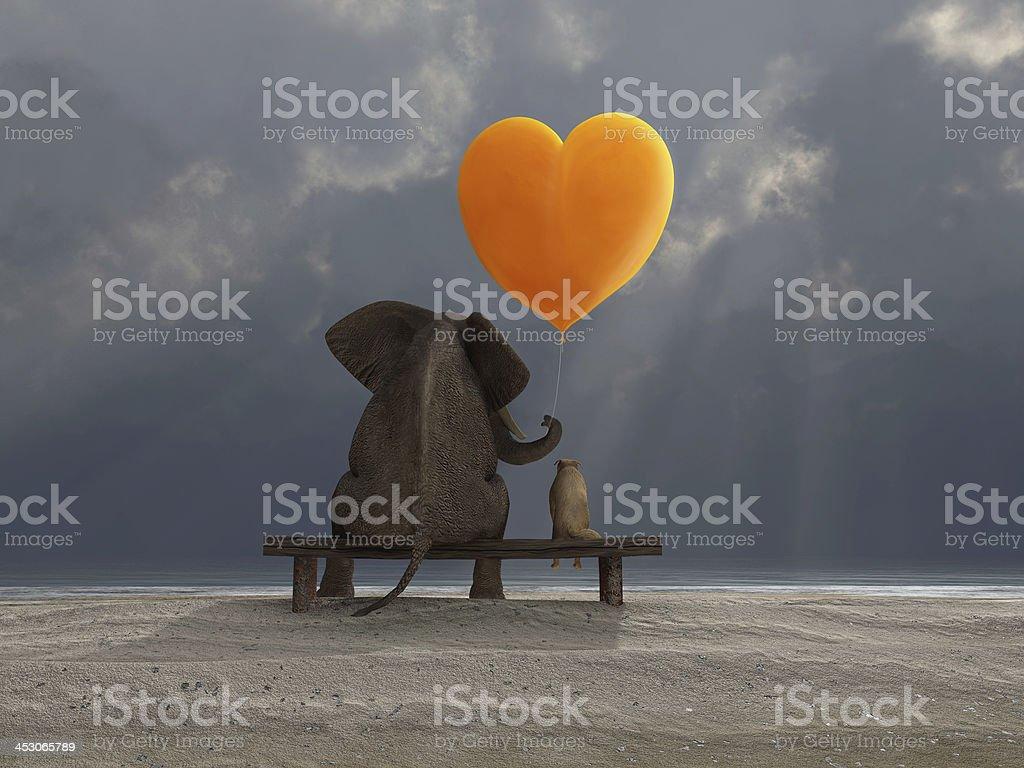 elephant and dog holding a heart shaped balloon royalty-free stock photo