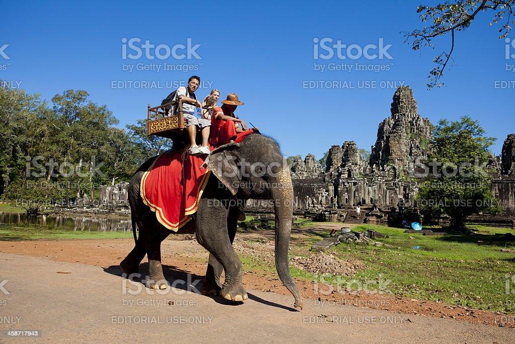 Elephant riding, Bayon in Angkor Thom, Cambodia royalty-free stock photo