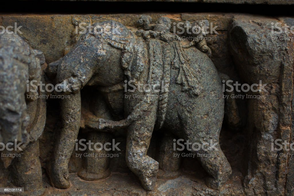 Elephant sculptures on the wall panel relief and molding frieze in horizontal treatment in Chennakesava Temple, Somanathapura stock photo