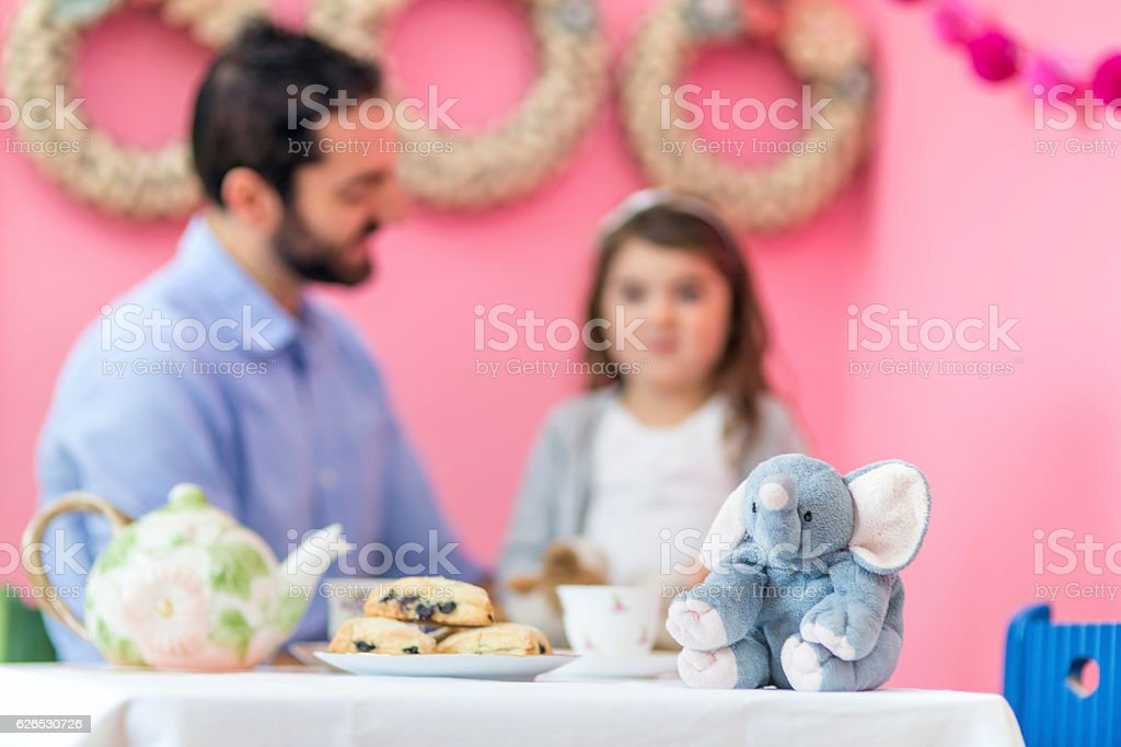 Elephant stuffed animal sitting on table for tea party stock photo