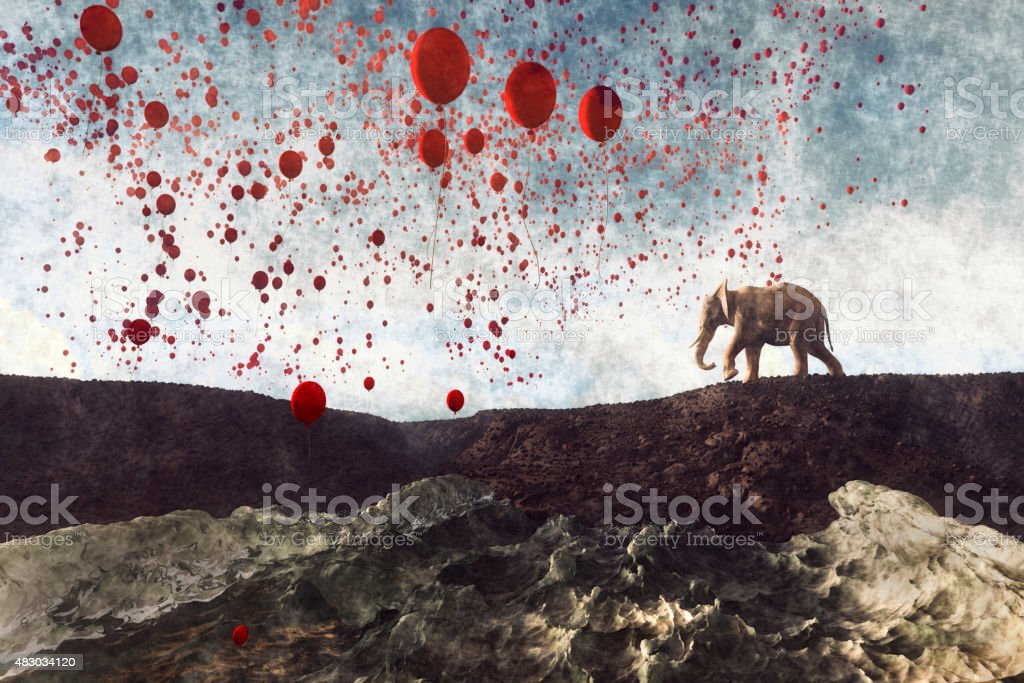 Elephant walking with millions of party balloons stock photo