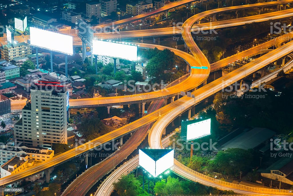 Elevated expressway and cityscape at night stock photo
