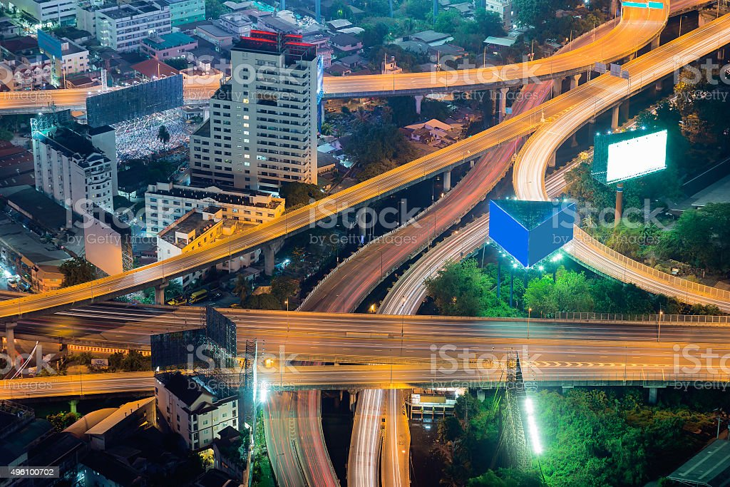 Elevated expressway intersection at night stock photo