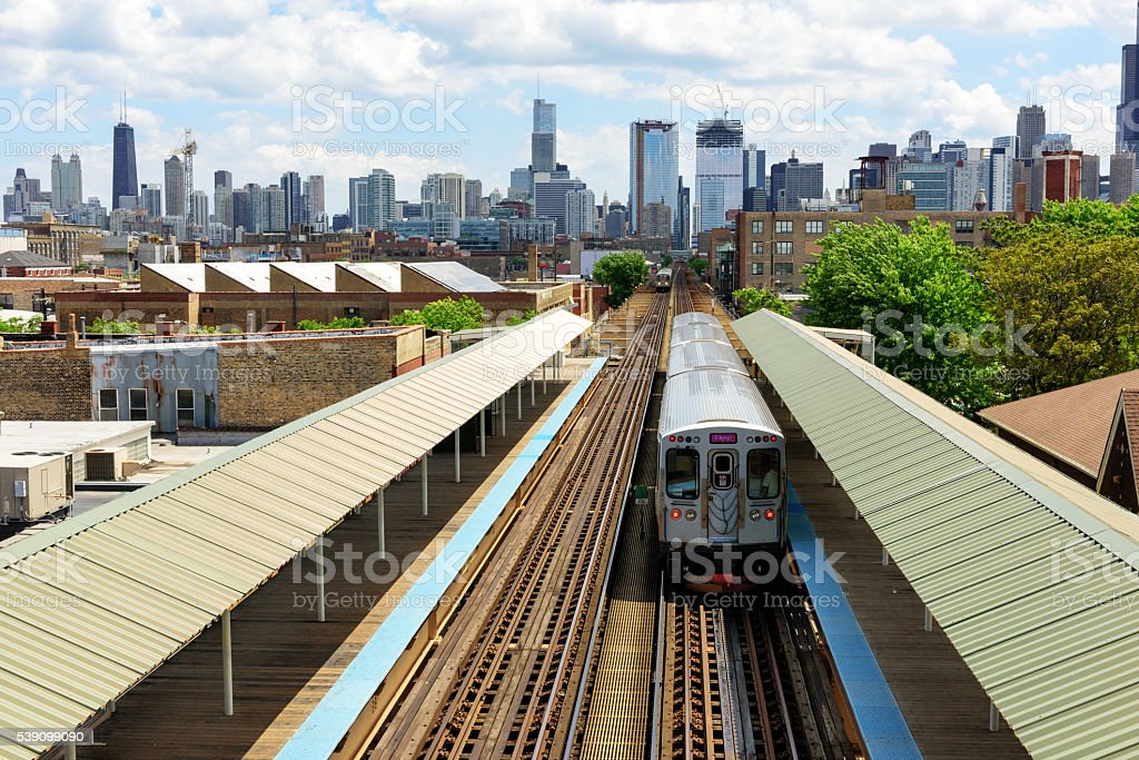 Elevated Railway train and Station in Chicago stock photo
