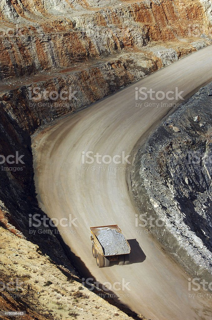Elevated view of a haul truck carrying ore. stock photo