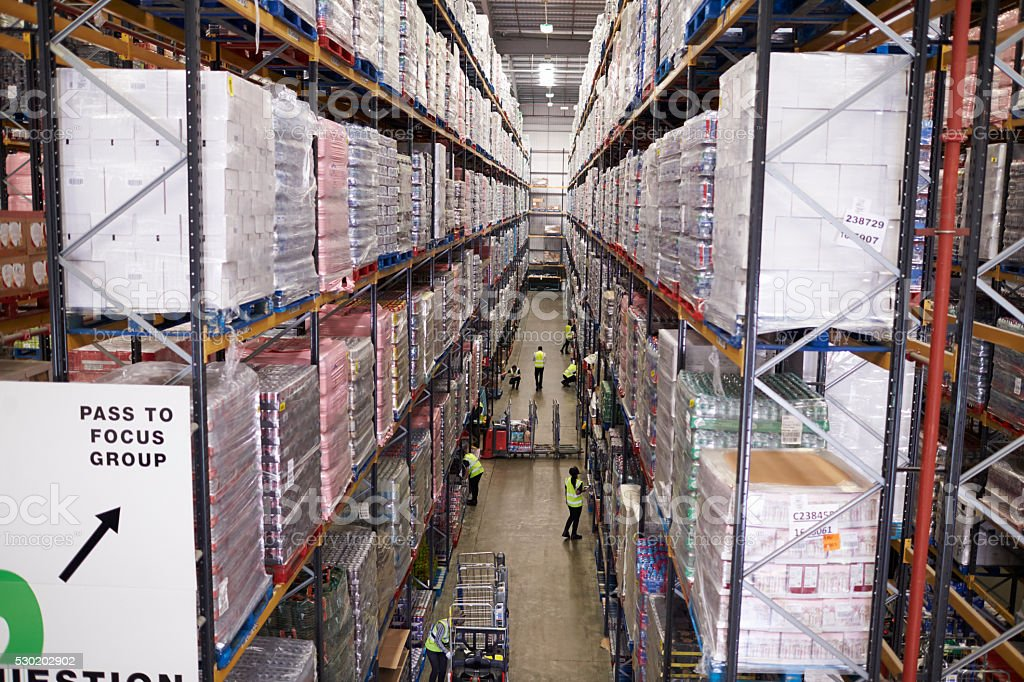 Elevated view of aisle between storage units in a warehouse stock photo