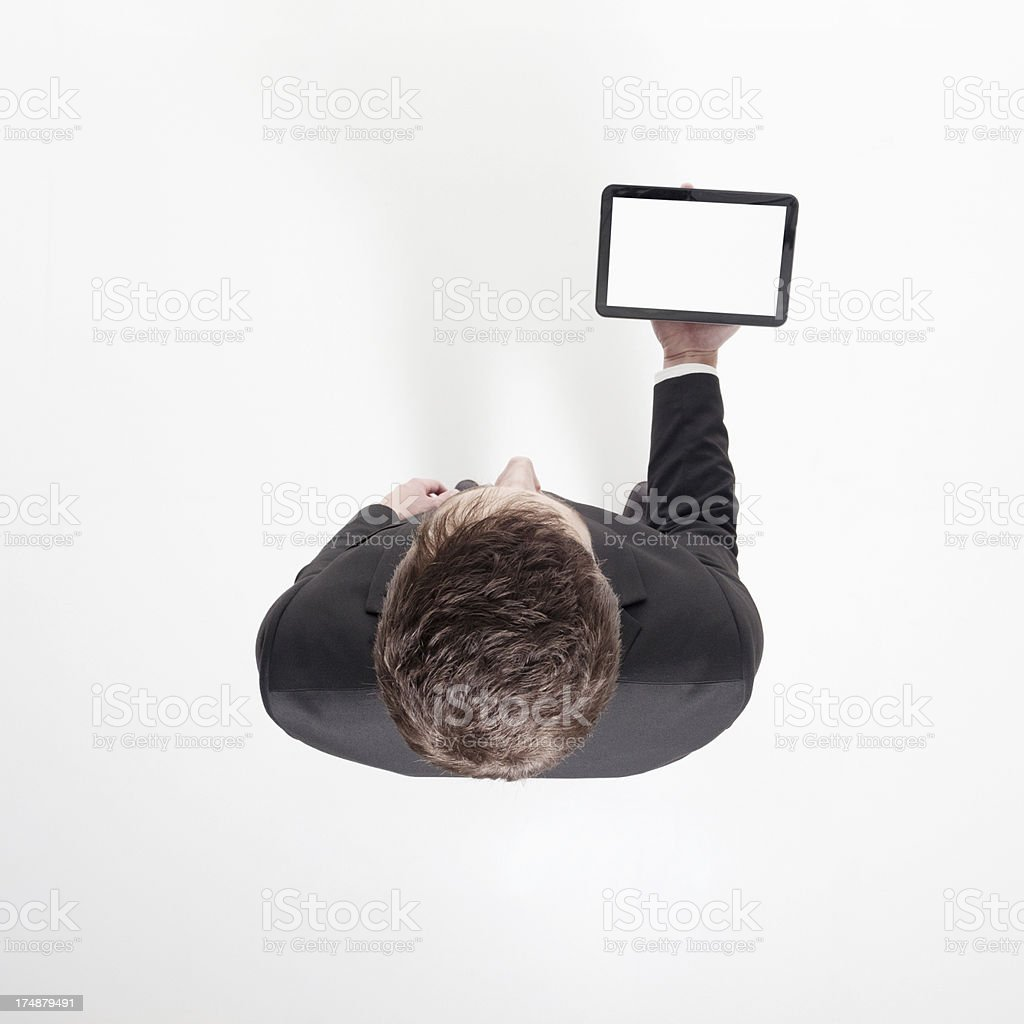 Elevated view of businessman holding a digital tablet royalty-free stock photo