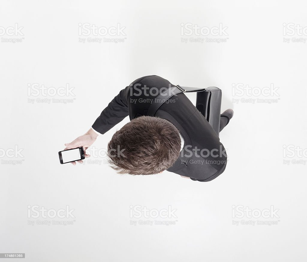 Elevated view of businessman holding a smart phone royalty-free stock photo
