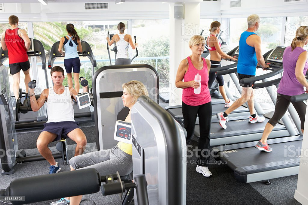 Elevated View Of Busy Gym With People Exercising On Machines stock photo