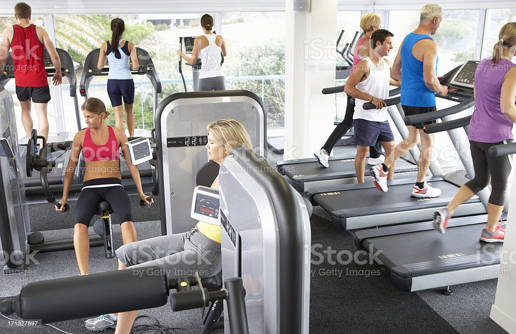 Elevated View Of Busy Gym With People Exercising On Machines royalty-free stock photo