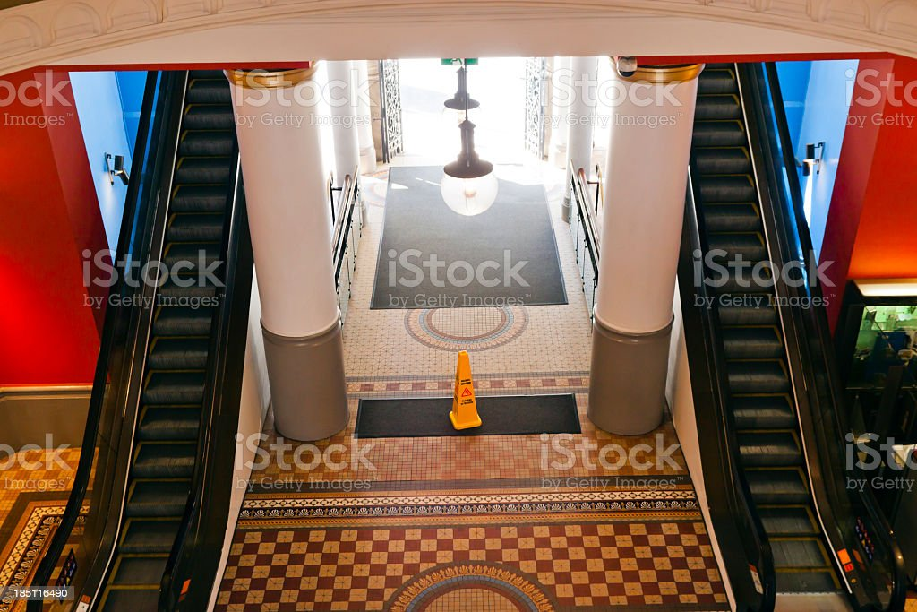 Elevated view of entry to the shopping centre with escalators royalty-free stock photo