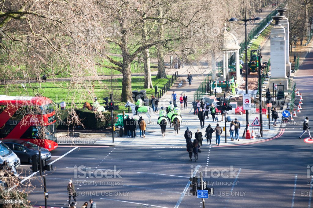 Elevated view of mounted police on Constitution Hill towards Westminister London on cold sunny winter day stock photo