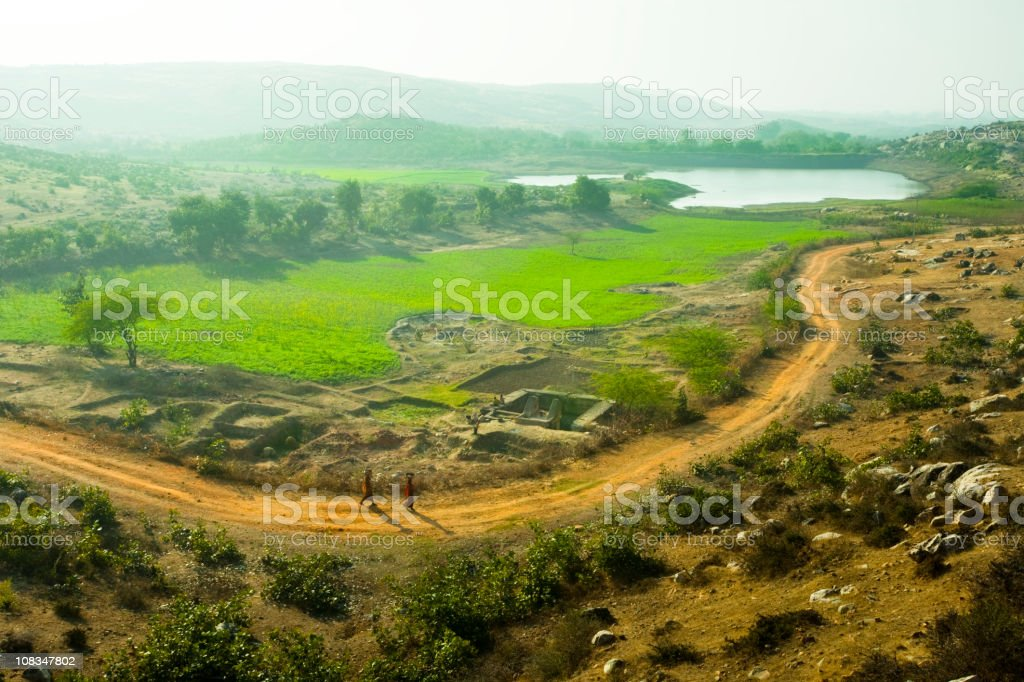 Elevated view of rural landscape, farm, road and pond royalty-free stock photo