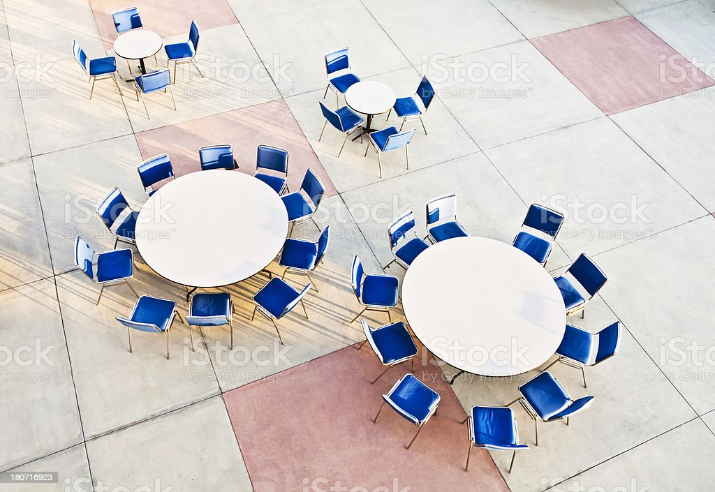 Elevated view round patio tables & blue chairs royalty-free stock photo