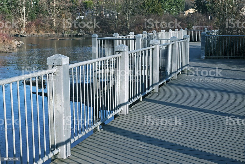 Elevated walkway above pond in northeast Seattle WA royalty-free stock photo