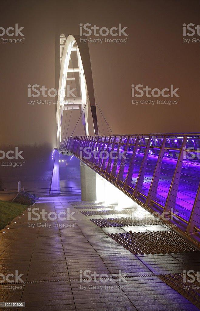 elevated walkway at night stock photo
